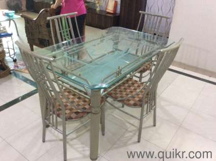 glass dining table with shelf underneath in malad east mumbai used